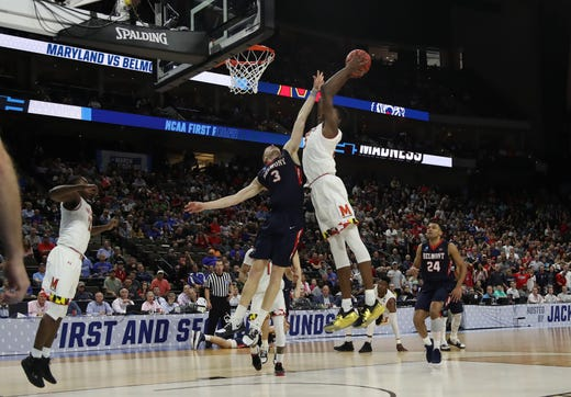 First round: Maryland's Jalen Smith throws down a huge dunk over Belmont's Dylan Windler in the Terps' win.