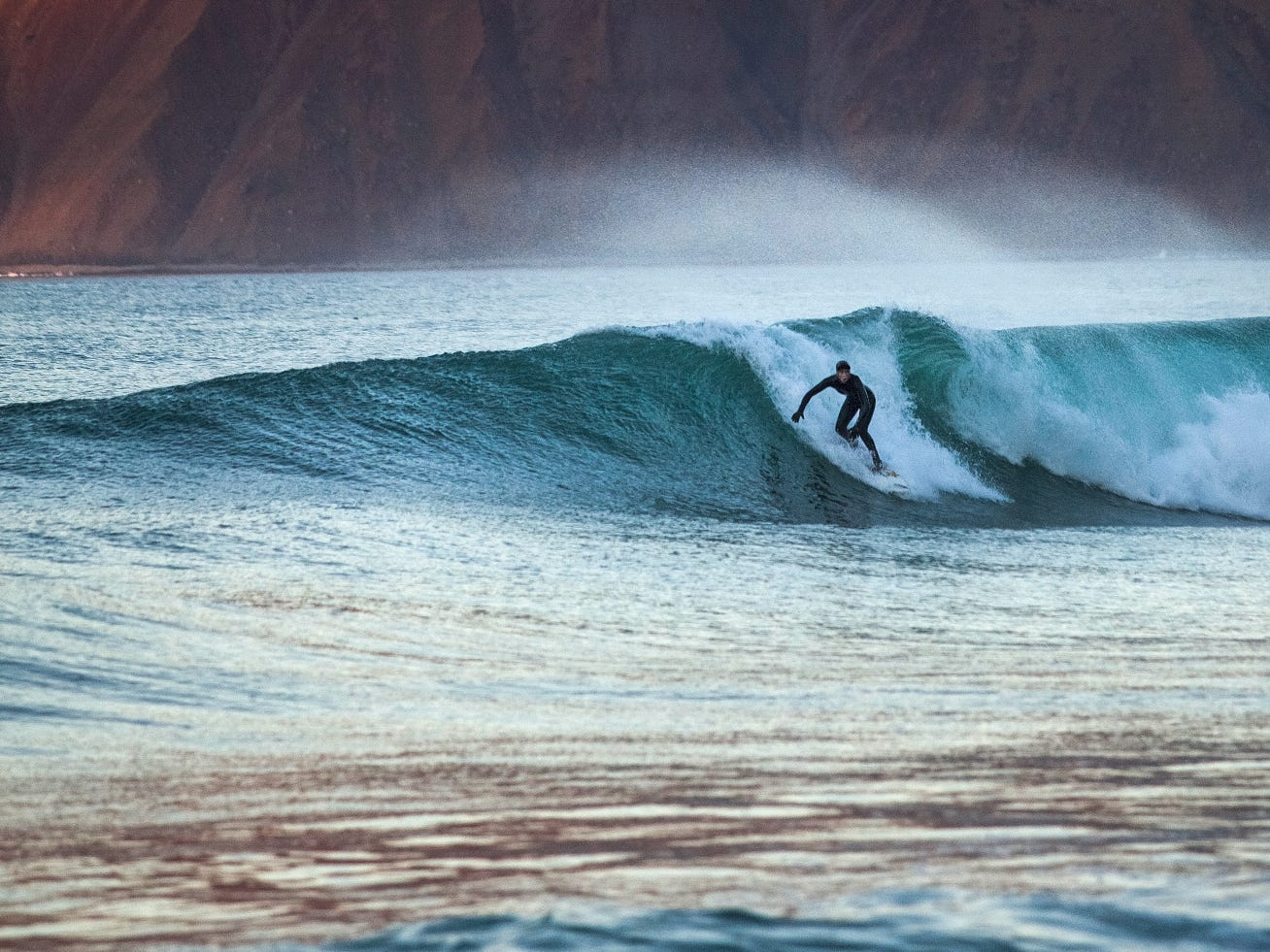 Although the water's chilly year-round, surfers still gravitate to the Reykjanes Peninsula near Iceland's capital of Reykjavik.