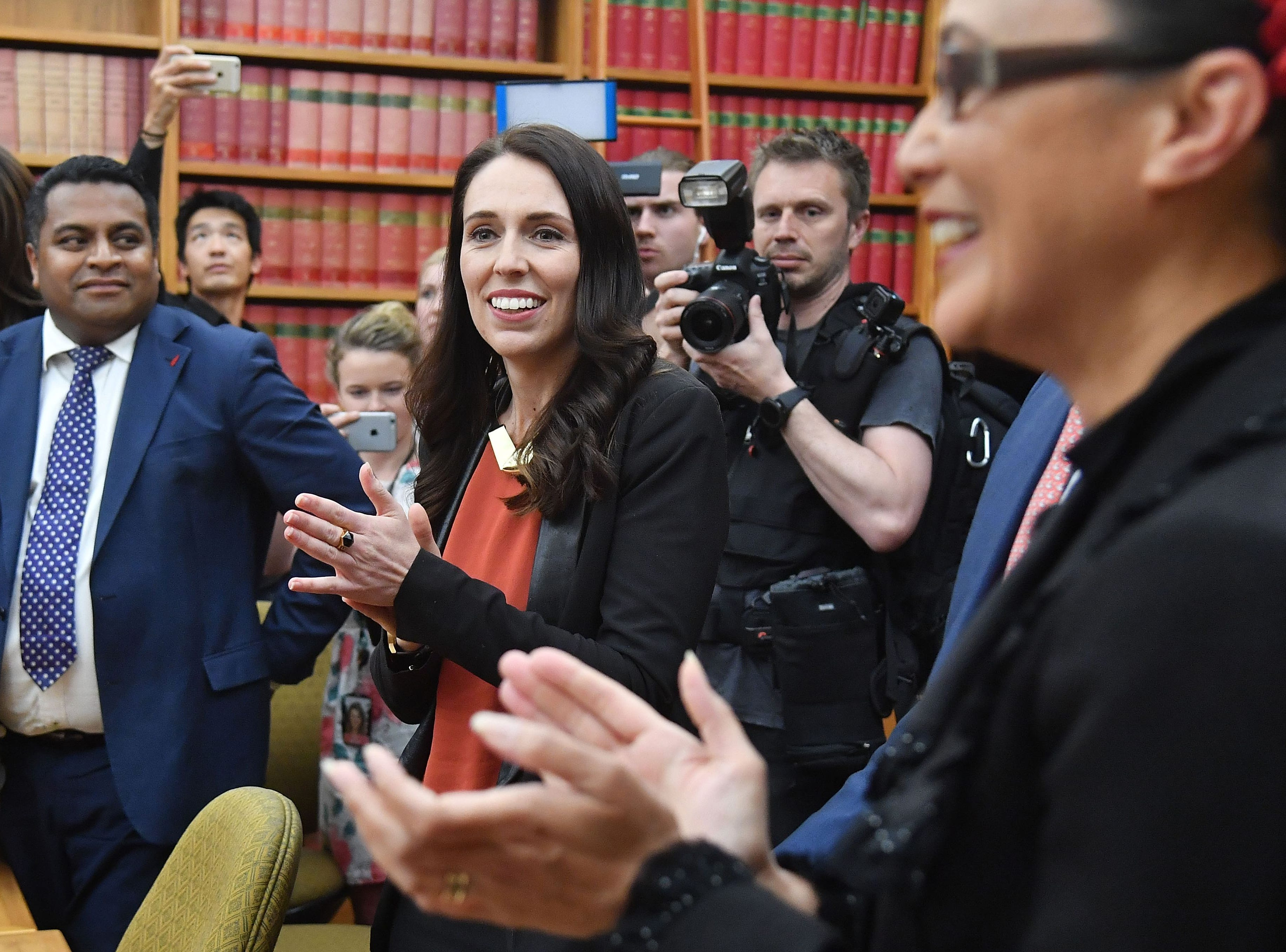 New Zealand's Labour party leader Jacinda Ardern receives applause as she is welcomed to her first caucus meeting as Prime Minister-elect at Parliament in Wellington on Oct. 20, 2017.New Zealand's Prime Minister-elect Jacinda Ardern expressed confidence October 20 that her new government would see out its full term, despite long-standing tensions between her coalition partners.