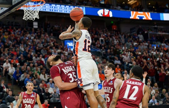 Auburn guard J'Von McCormick goes up for a shot over New Mexico State forward Johnny McCants during the first round of the 2019 NCAA tournament.