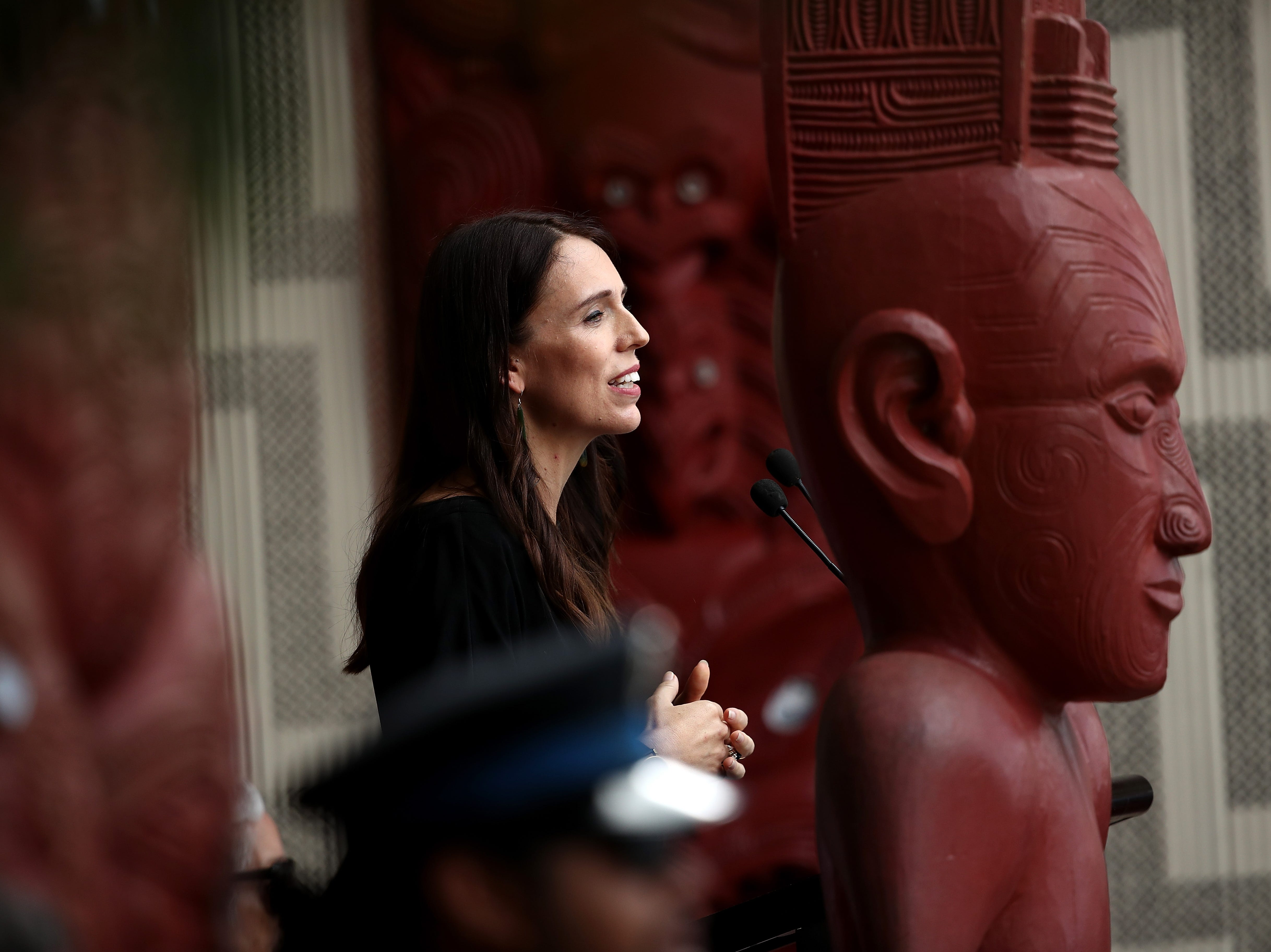 New Zealand Prime Minister Jacinda Ardern speaks on the veranda of Te Whare Runanga on the Waitangi Treaty Grounds on Feb. 5, 2018 in Waitangi, New Zealand. The Waitangi Day national holiday celebrates the signing of the treaty of Waitangi on February 6, 1840 by Maori chiefs and the British Crown, that granted the Maori people the rights of British Citizens and ownership of their lands and other properties.