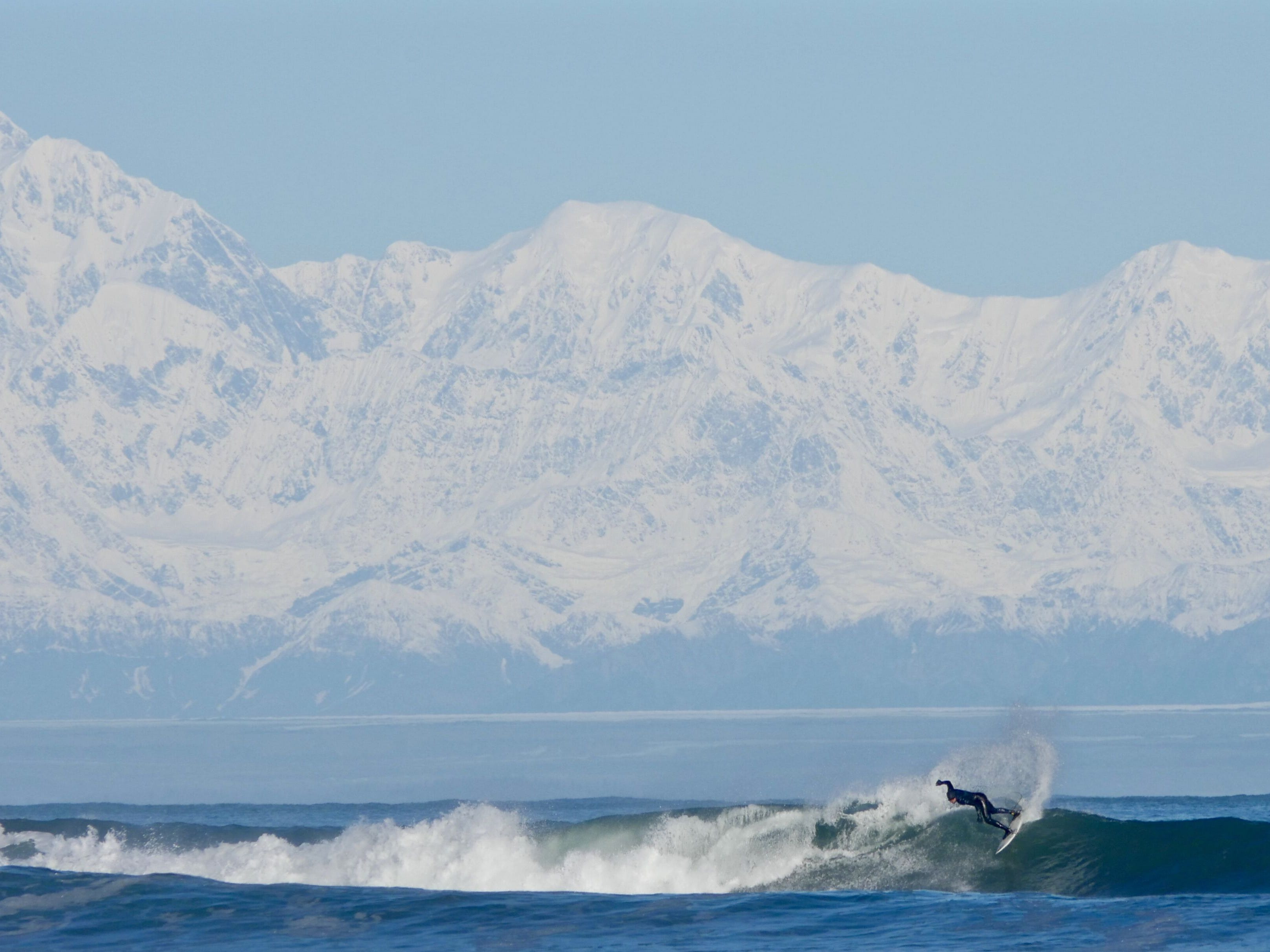 At the remote bay of Yakutat, Alaska, surfers can ride waves in the shadow of an 18,000-foot snow-capped mountain.
