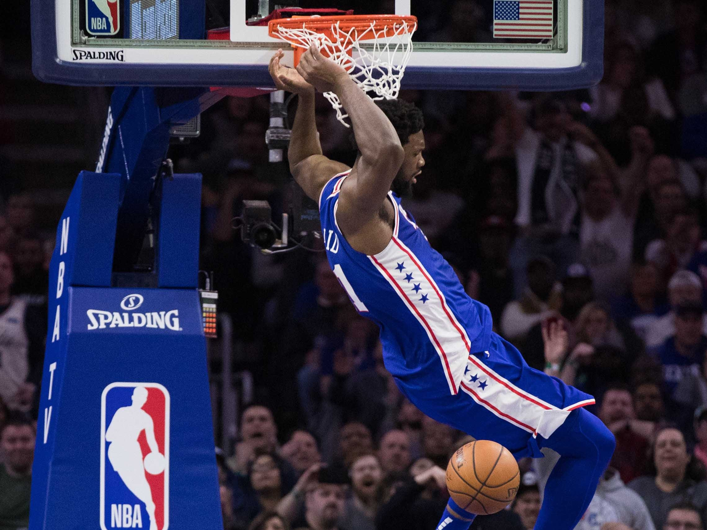 March 20: Philadelphia 76ers center Joel Embiid dunks on top of Boston Celtics forward Marcus Morris during the third quarter at Wells Fargo Center.