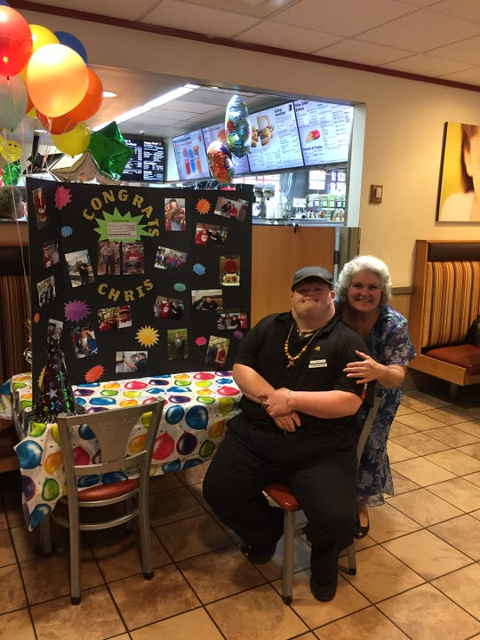 Chris Campbell and his mother Barbara Campbell pose during a celebration of Christopher's twenty-seventh year of employment at a Georgia McDonald's.