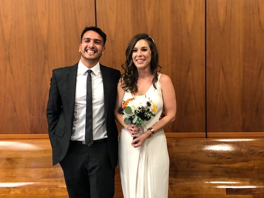 Laura Formisano and her husband Agustin Alvarez Escalante on their wedding day in Los Angeles. The couple have chosen not to have children, in part due to their worries about the changes global warming will have on the world today's children will grow up in.