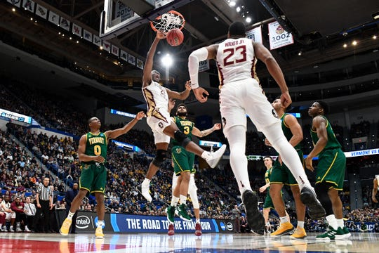 First round: Florida State Seminoles forward Mfiondu Kabengele, who had a game-high 21 points in the win over Vermont, slams it down with authority.