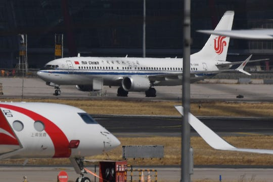 An Air China Boeing 737 Max 8 plane is seen at Beijing Capital Airport.  All of the  planes worldwide are grounded