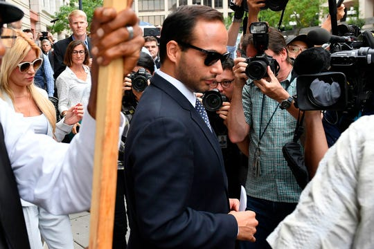 Distant places protection advisor to President Donald Trump's election campaign, George Papadopoulos and his wife Simona Mangiante Papadopoulos leave a federal court in Washington after his sentencing on September 7, 2018.