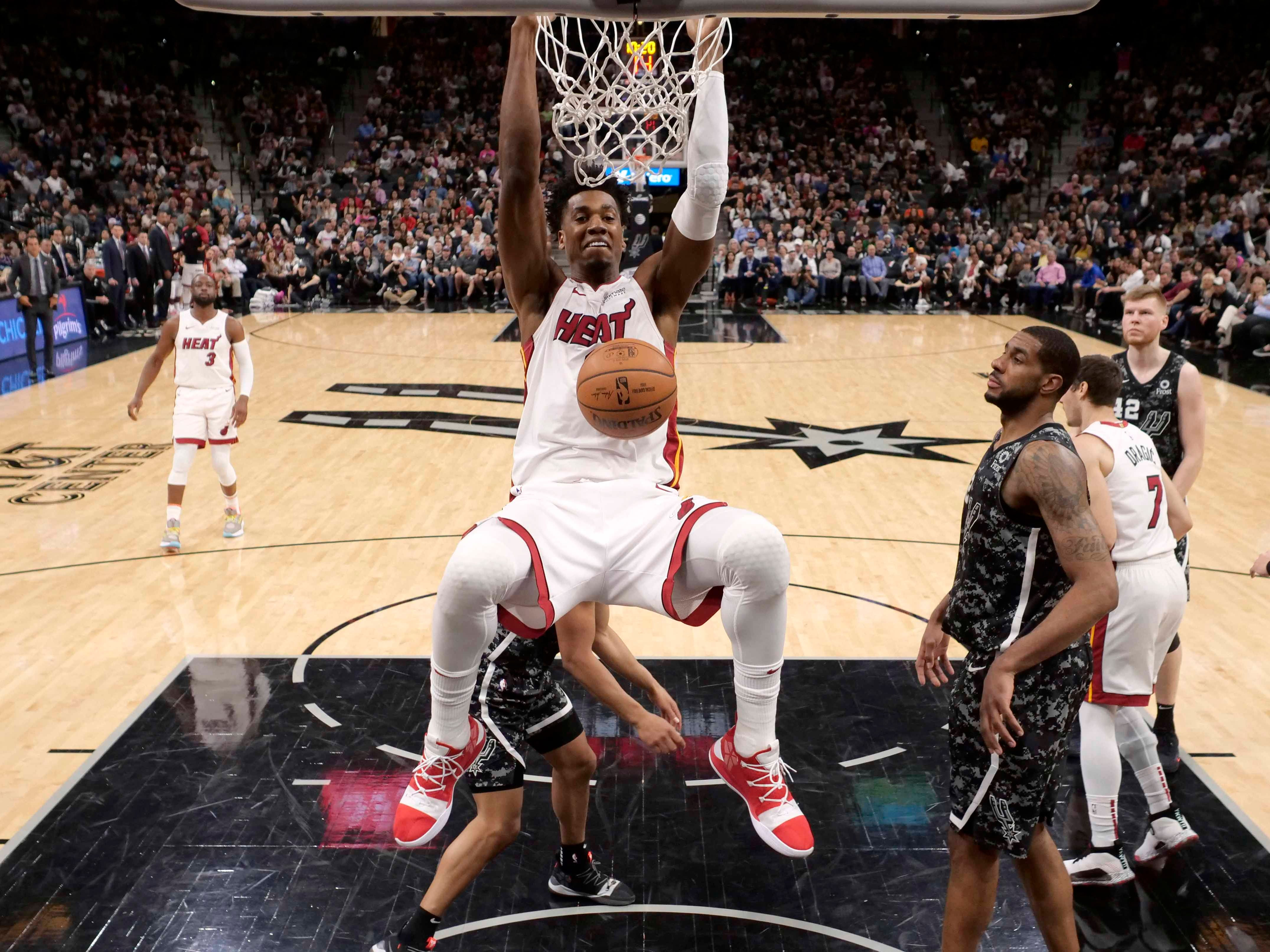 March 20: Miami Heat center Hassan Whiteside dunks the ball against the San Antonio Spurs.