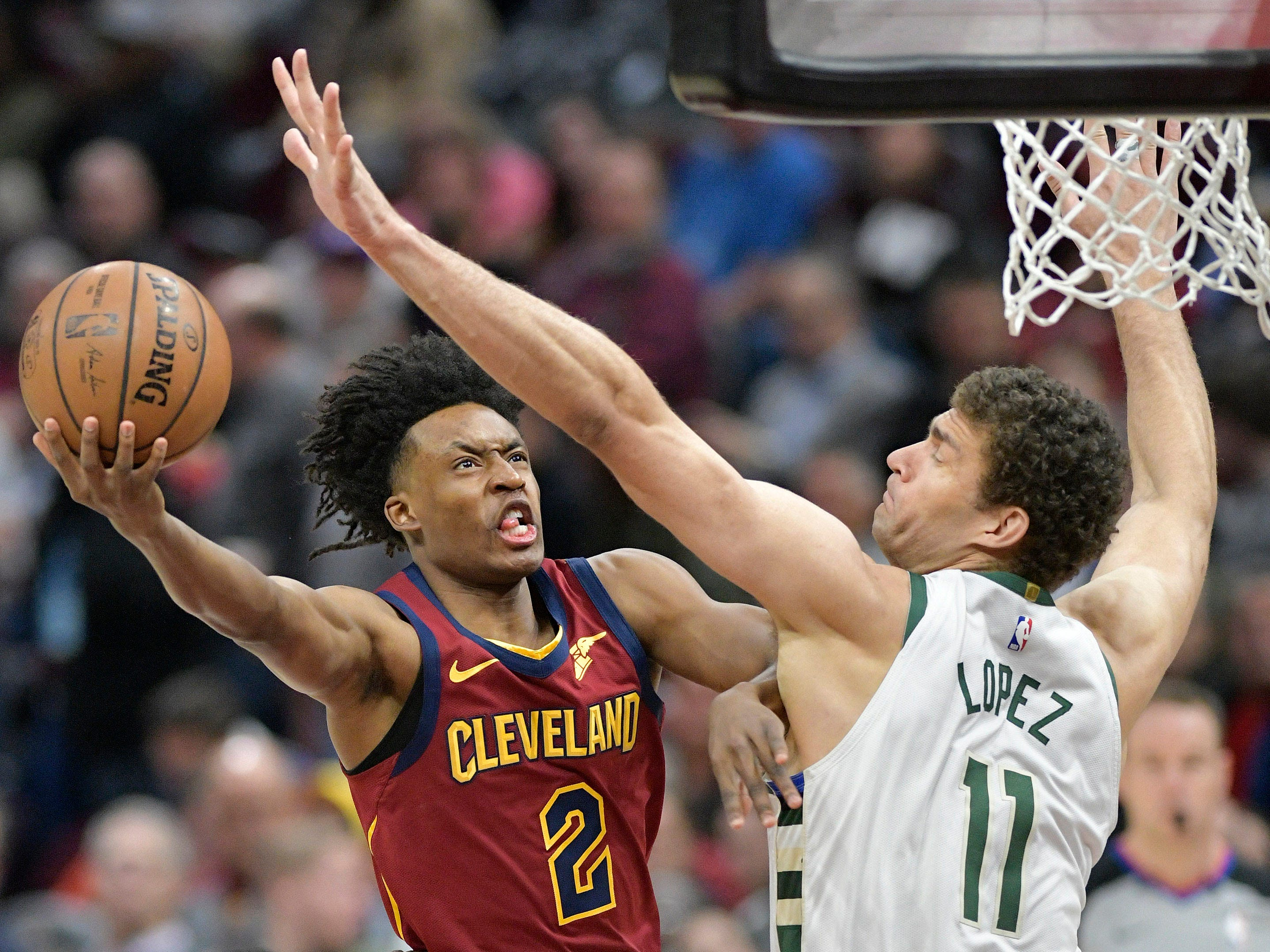 March 20: Cleveland Cavaliers guard Collin Sexton (2) shoots the ball around Milwaukee Bucks center Brook Lopez in the first quarter at Quicken Loans Arena. The Cavaliers won the game, 107-102.
