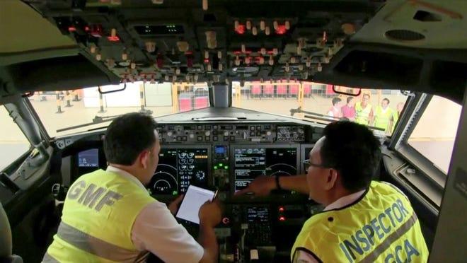 Officials inspect the the cockpit of a Boeing 737 Max 8 aircraft at Garuda Maintenance Facility at Soekarno Hatta airport, Jakarta.
