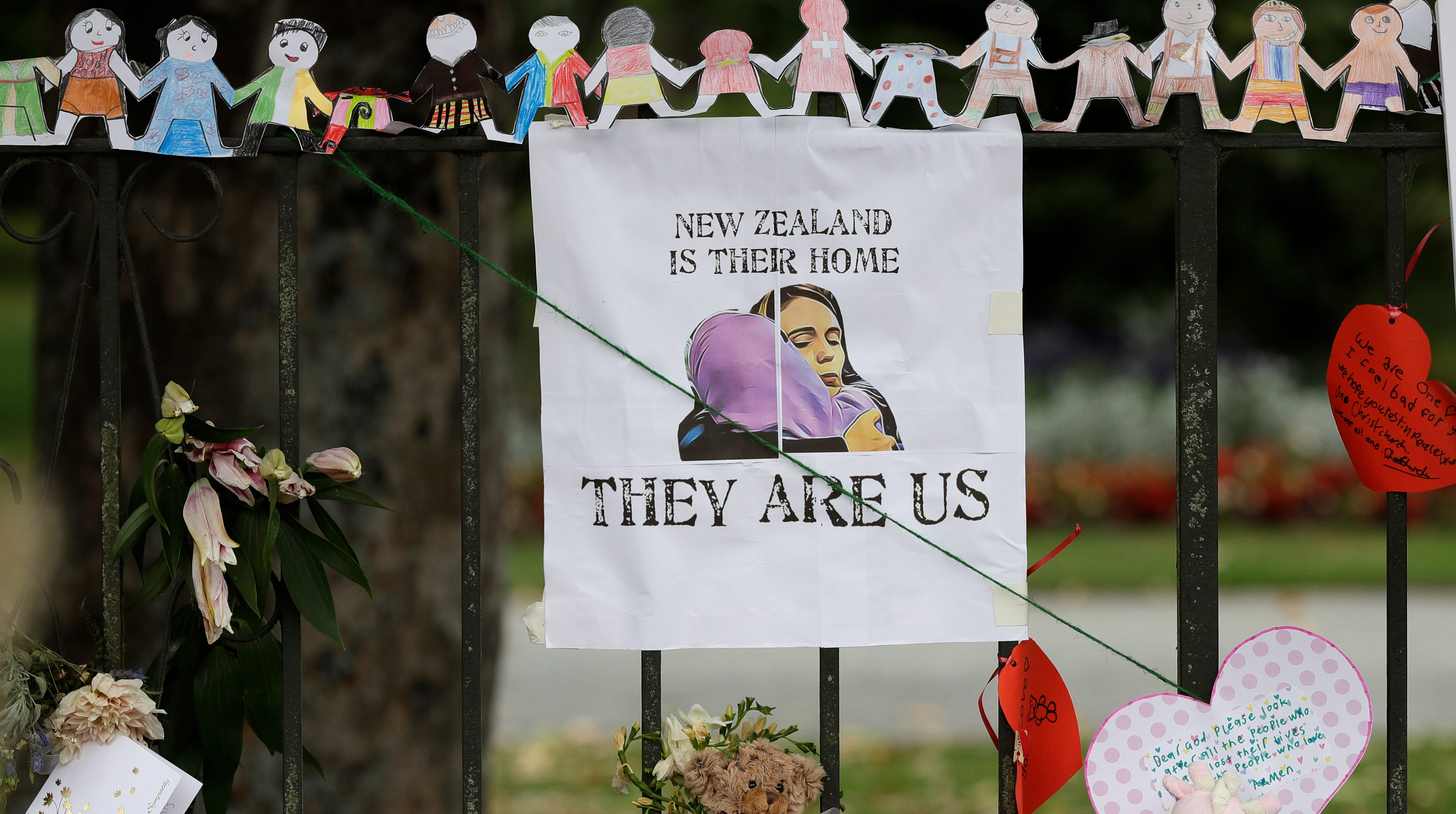 A poster featuring a drawing of Prime Minister Jacinda Ardern hangs on a wall at the Botanical Gardens in Christchurch, New Zealand, Thursday, March 21, 2019.
