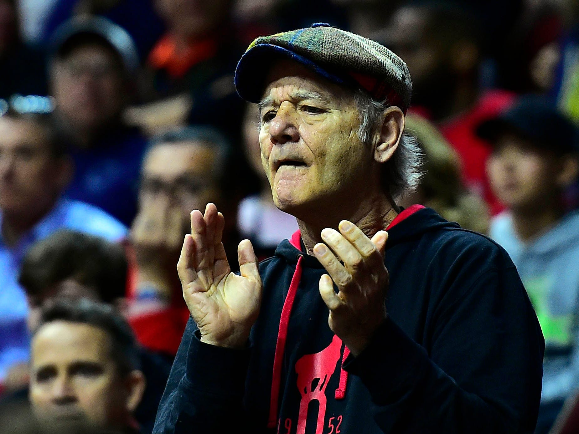 Come March, you are far more likely to find Bill Murray in the stands at NCAA basketball games than on a movie set. The Oscar nominee is also dad to Luke Murray, an assistant college b-ball coach in his first season at the University of Louisville. Here, he cheers on the Cardinals during their first-round game against Minnesota on March 21, 2019.