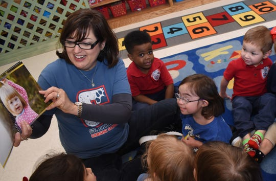 "St. Frances Cabrini School pre-Kindergarten teacher Gail Callahan reads ""The Upside of Downs"" to her pre-Kindergarten 3 class last year. The book was written by Cabrini third-grade teacher, Ashley Distefano, whose daughter Elizabeth Butler, 4 (right) has Down Syndrome. Elizabeth was recently diagnosed with leukemia. A fundraiser is set for Thursday, Sept. 26, 2019 to help the family with treatment and transportation expenses."