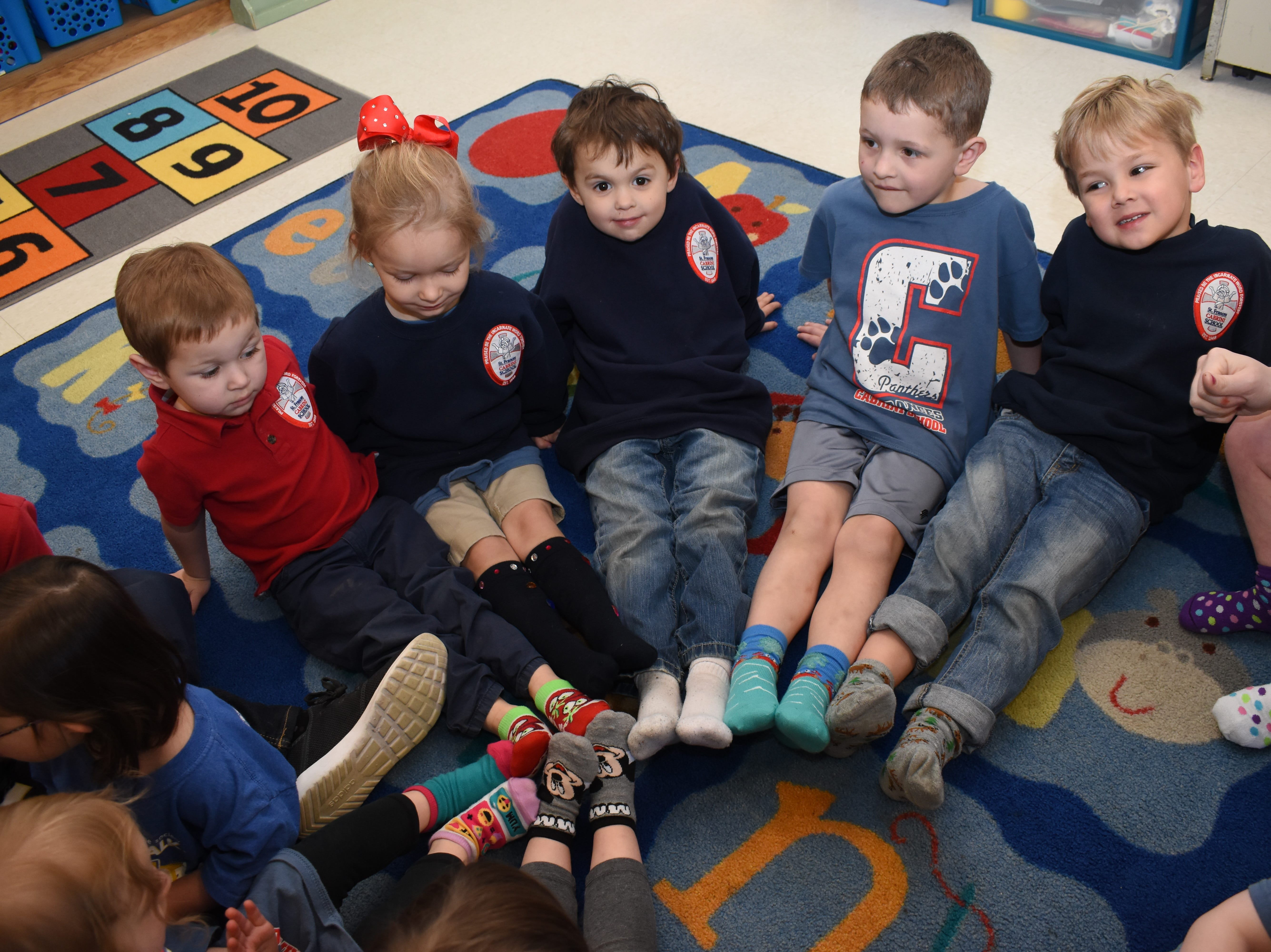 """Students at St. Frances Cabrini School celebrated World Down Syndrome Day Thursday, March 21, 2019. """"Rock Your Socks"""" was the theme for the day. For $2 students could wear crazy socks with jeans and a spirit shirt. Gail Callahan, a pre-Kindergarten three teacher, read a book to her class written by another Cabrini teacher Ashley Distefano, titled """"The Upside of Downs."""" The book was written for Distefano's daughter Elizabeth Butler, 4, a student of Callahan's, who has Down syndrome. The book also features another Cabrini Student who has Down, Sydney Rud, 4."""