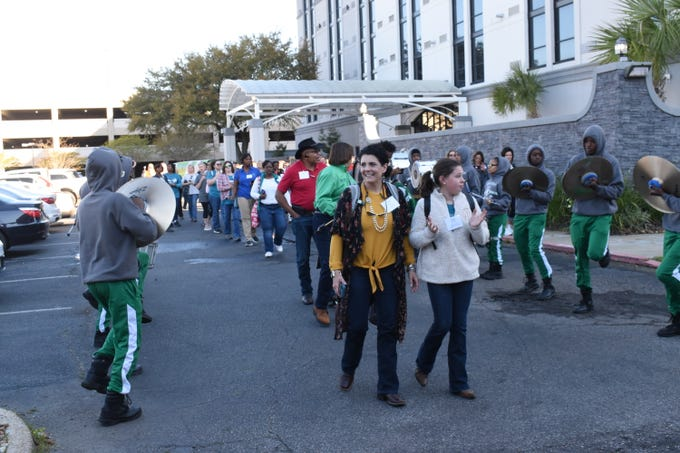"The Louisiana Women in Ag Conference kicked off Thursday, March 21, 2019 from the Holiday Inn in downtown Louisiana with the Peabody High School Marching Band sending off over 200 participants on bus tours to North and South Louisiana. Those going to North Louisiana learned about a high tunnel, or a Òhoop house,"" bee keeping and were given a small farming tools demonstration. Those going to South Louisiana toured a crawfish farm and rice mill. The conference continues Friday with keynote speakers Jane Jenkins Herlong and Marji Guyler Aliniz; Donna Bailey of Roy O Martin speaking on Women in Leadership; and panel discussions on buying and selling local and ideas and innovation. Donna Edwards, first lady of Louisiana, and Mike Strain, commissioner of the department of agriculture and forestry, are also slated to speak at the conference."
