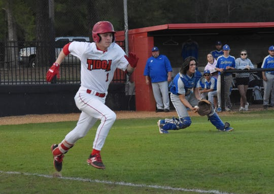 Tioga's Blake McGehee (1) tries to beat the throw against Deridder High School Thursday, March 21, 2019. McGehee was named as the LSWA Class 4A MVP in baseball.