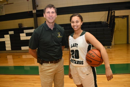 Mike Charrier (left), girls basketball coach at Hicks High School, is the All-Cenla coach of the year and Naomi Lewis, Rapides High School guard, is the All-Cenla MVP.