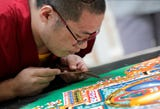 Buddhist monks from Depung Loseling Monastery create a sacred mandala at The Paine Art Center and Gardens in Oshkosh.