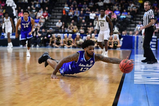 Seton Hall Pirates guard Myles Powell (13) reaches for a loose ball against the Wofford Terriers