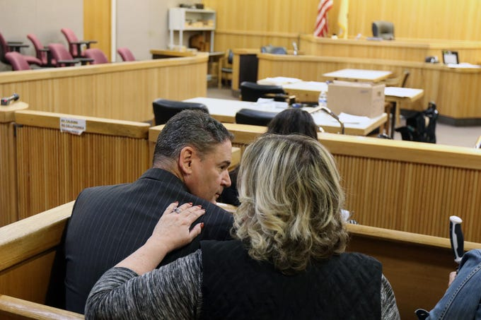 Peter Pflug of Freehold, former chief financial officer for new Horizons in Autism, for stealing almost $115,000 from the non-profit organization, sits with his family before he is sentenced before Judge Ellen Torregrossa-O'Connor at Monmouth County Courthouse in Freehold, NJ Friday, March 22, 2019.