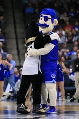 Wofford Terriers and Seton Hall Pirates mascot hug on the court during a stoppage in play the first half