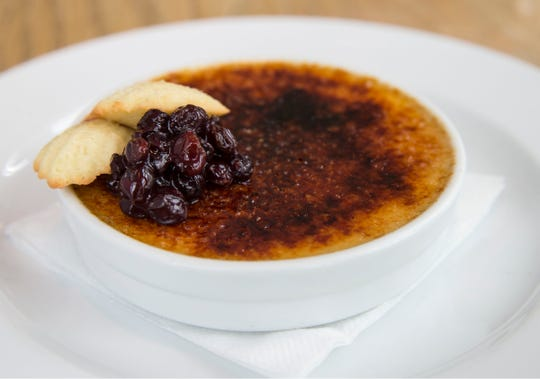 Creme brulee with black currants and a lemon madeline at Avenue in Long Branch.