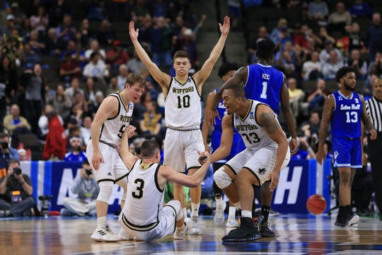 Wofford Terriers guard Fletcher Magee (3) celebrates with teammates after scoring against the Seton Hall Pirates