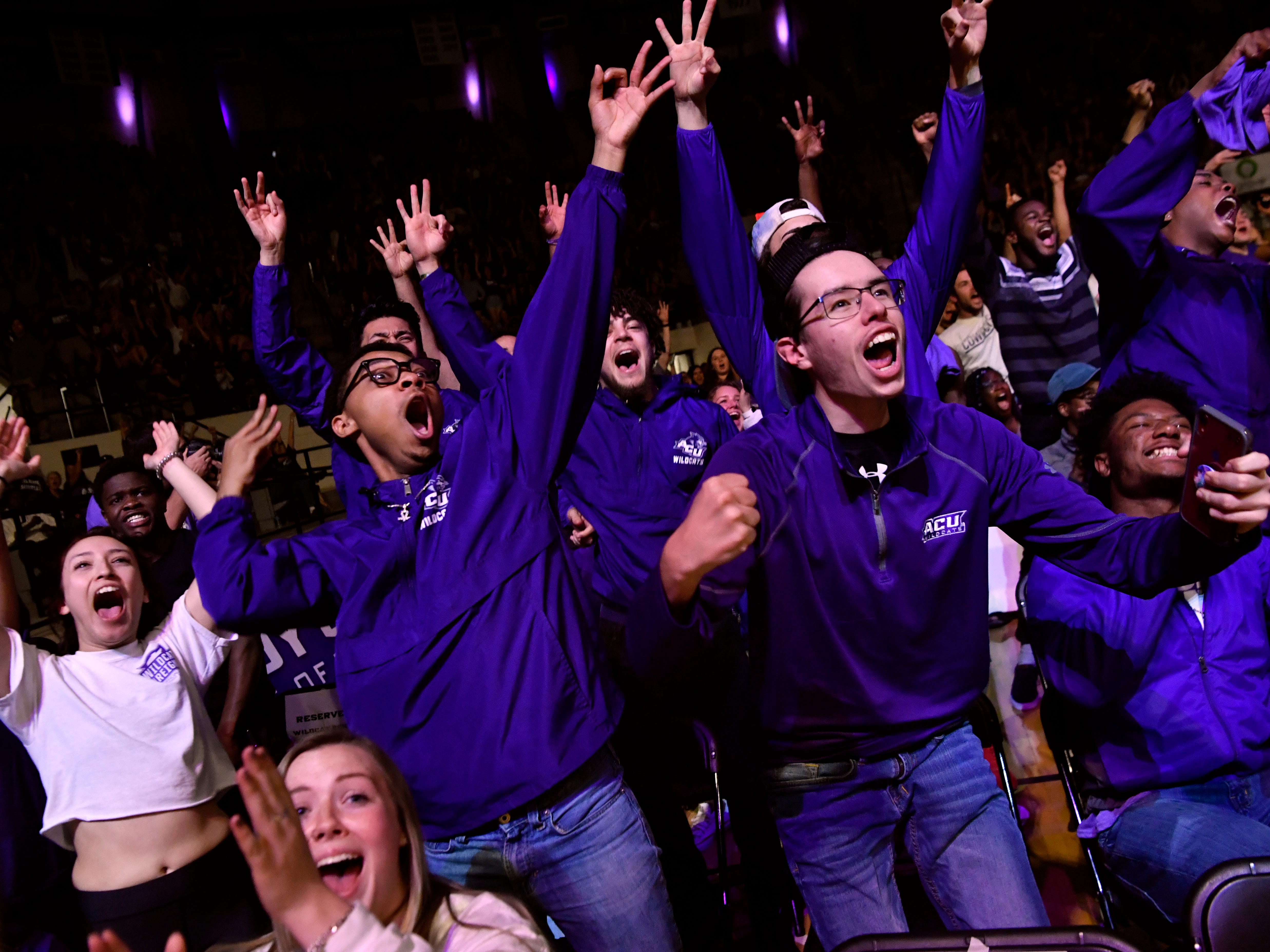 Fans erupt in cheers during a watch party at Abilene Christian University's Moody Coliseum as the Wildcats sink their first three-point basket against the University of Kentucky Thursday March 21, 2019. The ACU men took on the basketball powerhouse in their first-ever trip to the NCAA Tournament, ending with a loss to No. 2 UK, 79-44.