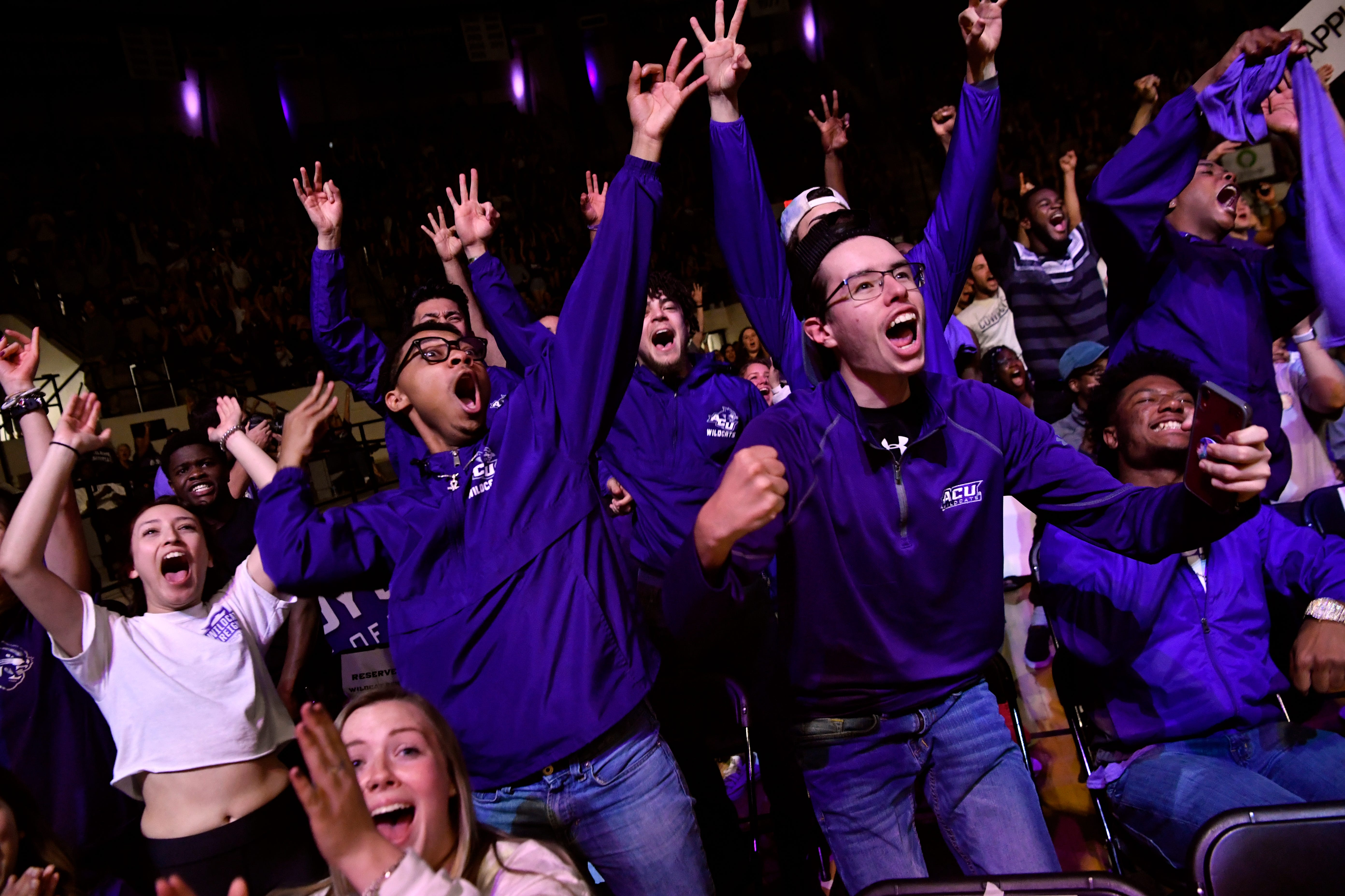 Fans erupt in cheers during a watch party at Abilene Christian University's Moody Coliseum as the Wildcats sink their first three-point basket against the University of Kentucky on Thursday. The ACU men took on the basketball powerhouse in their first trip to the NCAA Tournament, ending with a loss to No. 2 UK, 79-44.