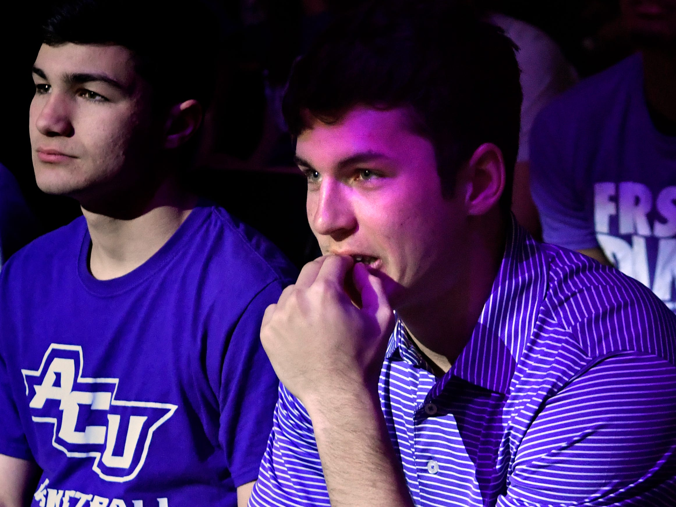 Steven Teel puts a hand to his chin as he watches with Andy McGrew the Abilene Christian University men play Kentucky during a watch party Thursday March 21, 2019 at Moody Coliseum. ACU ended their first-ever trip to the NCAA Tournament with a loss to UK, 79-44.