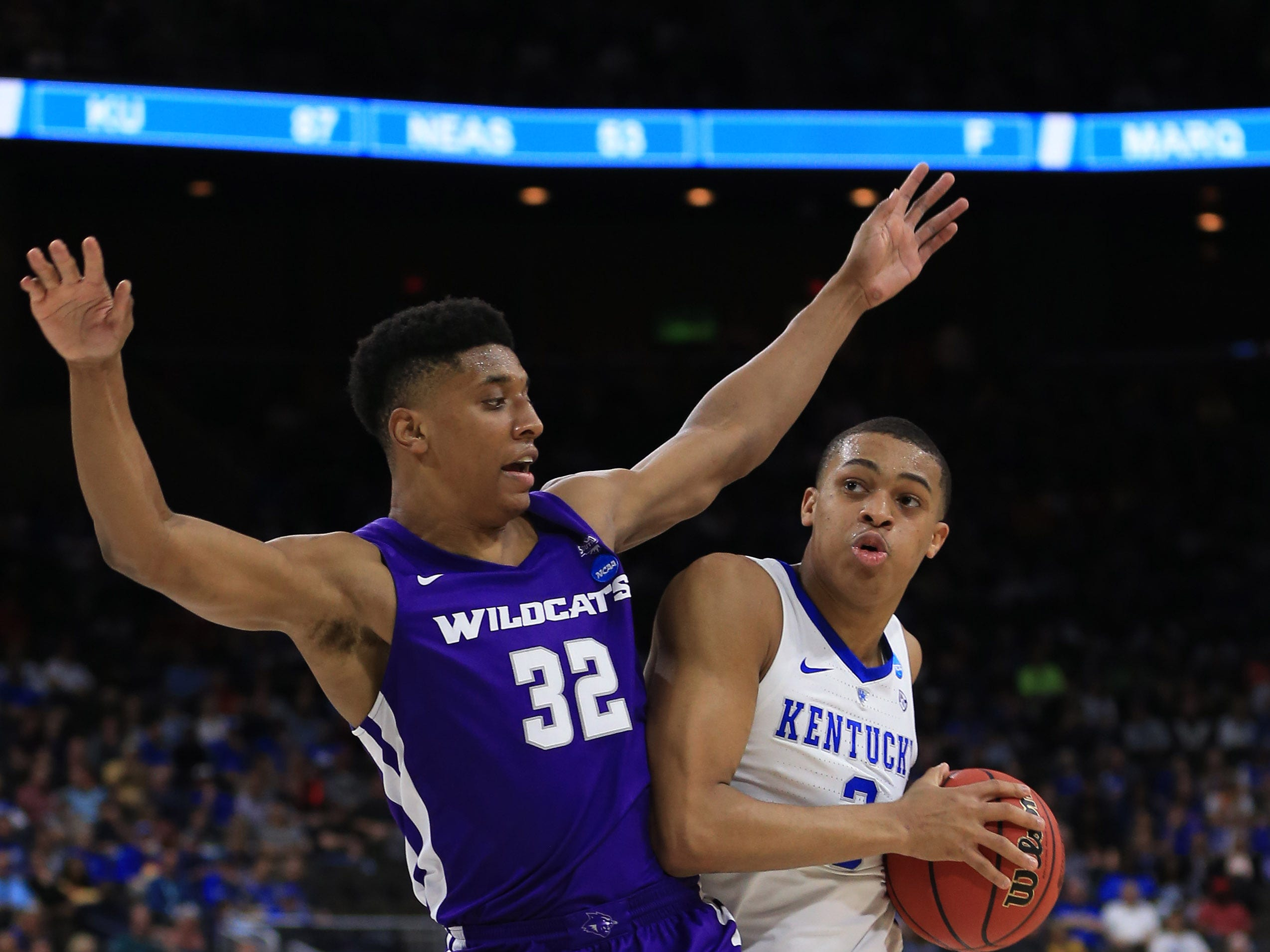 Mar 21, 2019; Jacksonville, FL, USA; Kentucky Wildcats guard Keldon Johnson (3) dribbles the ball as Abilene Christian Wildcats forward Joe Pleasant (32) defends during the first half in the first round of the 2019 NCAA Tournament at Jacksonville Veterans Memorial Arena. Mandatory Credit: Matt Stamey-USA TODAY Sports