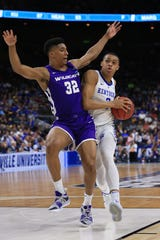 Kentucky guard Keldon Johnson (3) drives to the basket as ACU forward Joe Pleasant (32) defends during the first half in the first round of the 2019 NCAA tournament on March 21 at Jacksonville Veterans Memorial Arena. Pleasant is one of seven returning players for the Wildcats.
