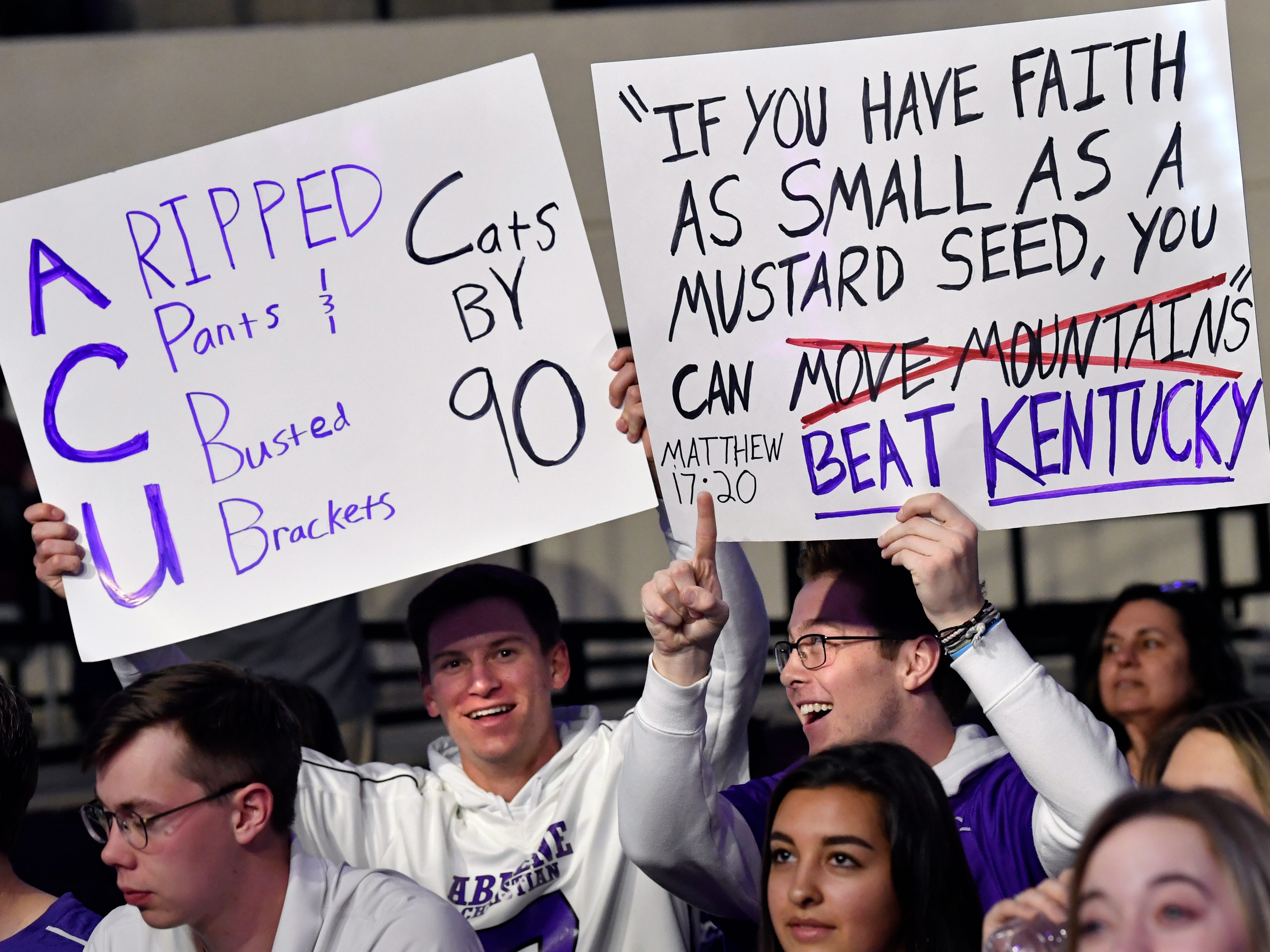 Fans hold signs at the start of Thursday's watch party at Abilene Christian University's Moody Coliseum March 21, 2019. The ACU men took on basketball powerhouse University of Kentucky in their first-ever trip to the NCAA Tournament. Final score was 79-44, Kentucky.