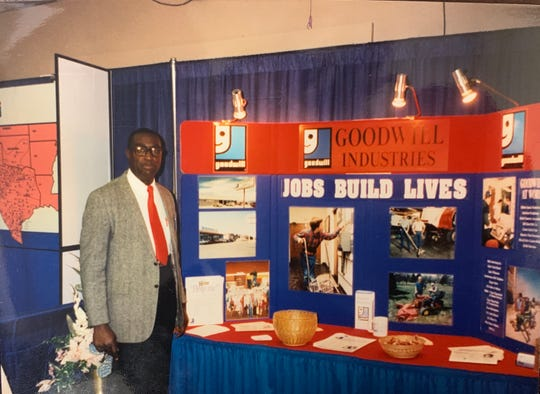 Former Goodwill - West Texas employee Fred Patterson at a Business Expo booth in 1998.
