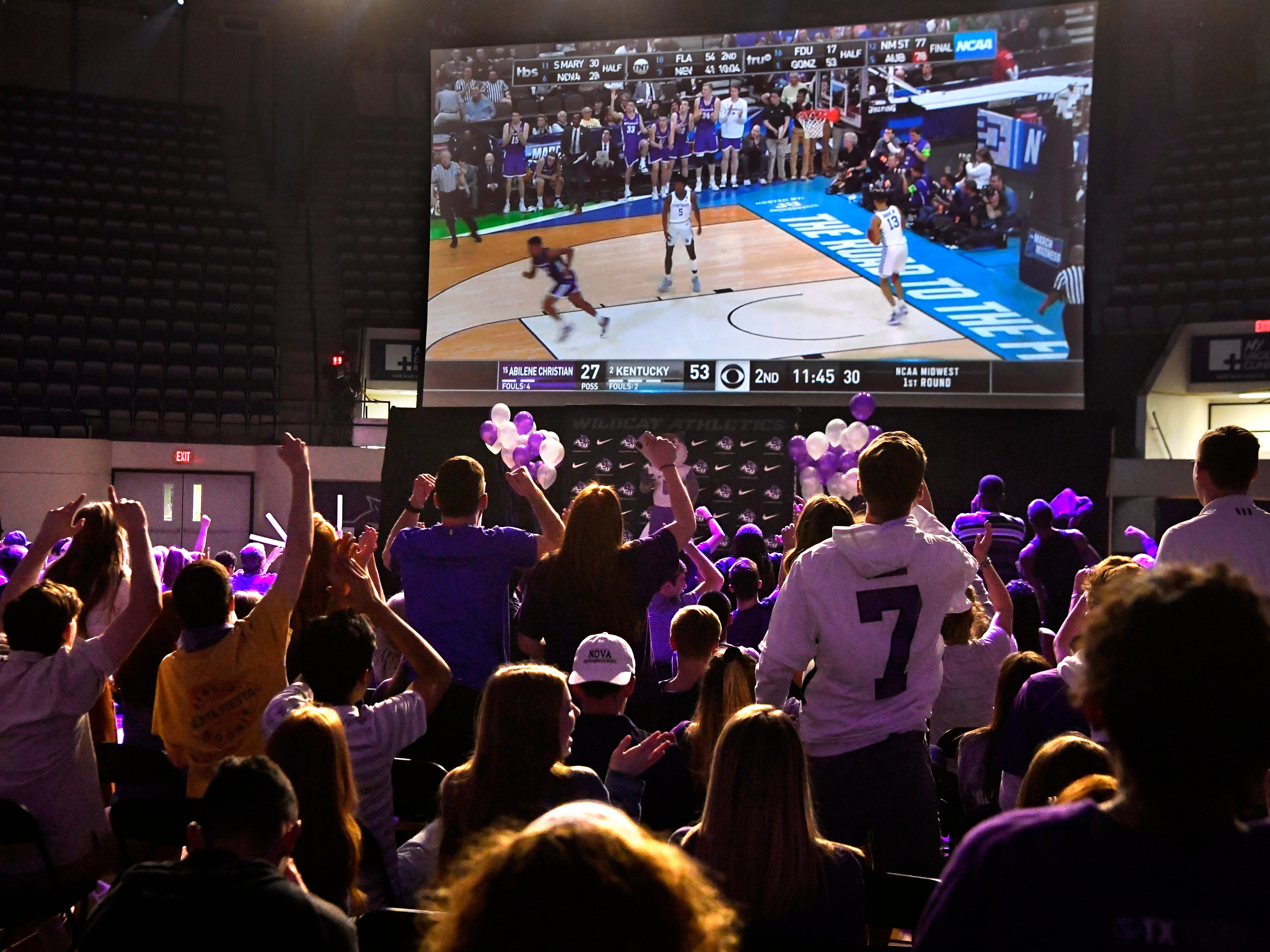 Fans cheer a Wildcat basket during a watch party at Abilene Christian University's Moody Coliseum Thursday March 2,1 2019. ACU took on basketball powerhouse University of Kentucky in their first-ever trip to the NCAA Tournament. ACU lost to No. 2 UK, 79-44.