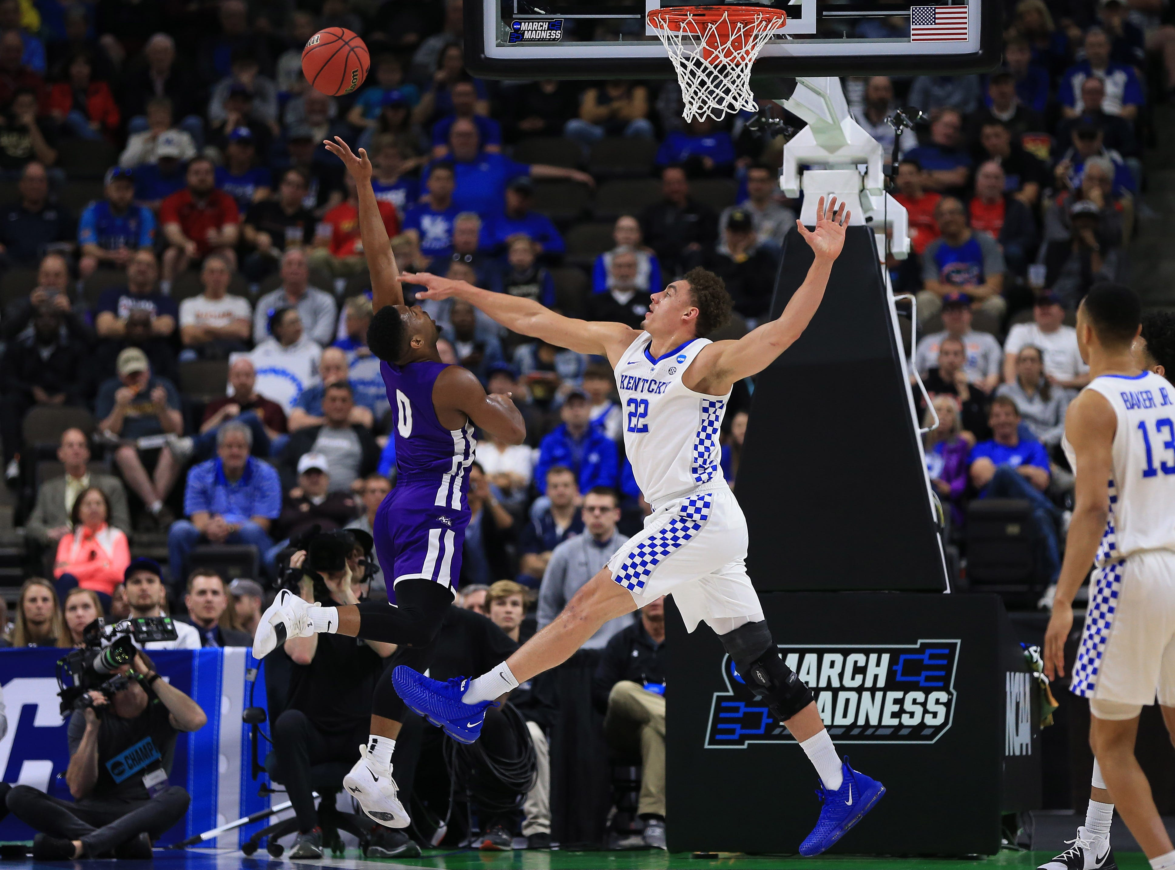 Mar 21, 2019; Jacksonville, FL, USA; Kentucky Wildcats forward Reid Travis (22) blocks a shot by Abilene Christian Wildcats guard Jaylen Franklin (0) during the first half in the first round of the 2019 NCAA Tournament at Jacksonville Veterans Memorial Arena. Mandatory Credit: Matt Stamey-USA TODAY Sports
