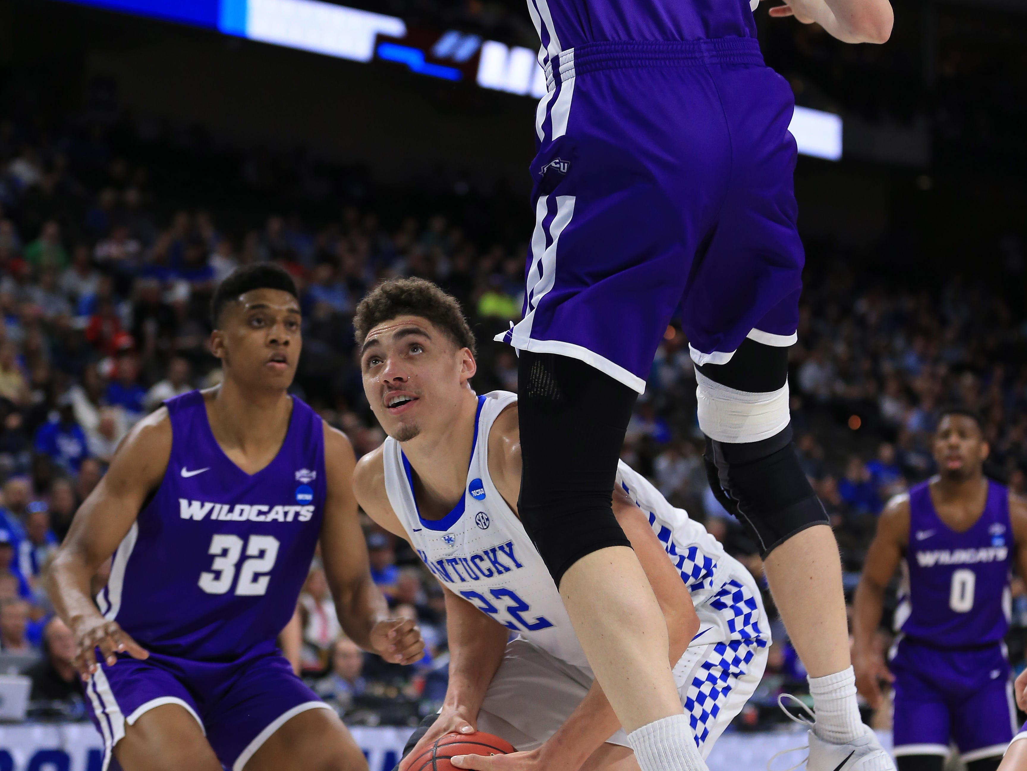 Mar 21, 2019; Jacksonville, FL, USA; Kentucky Wildcats forward Reid Travis (22) controls the ball between Abilene Christian Wildcats forward Joe Pleasant (32) and Wildcats center Kolton Kohl (34) during the first half in the first round of the 2019 NCAA Tournament at Jacksonville Veterans Memorial Arena. Mandatory Credit: Matt Stamey-USA TODAY Sports