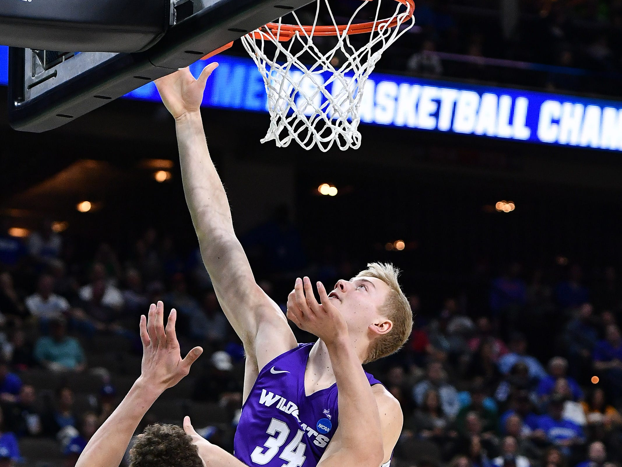 Mar 21, 2019; Jacksonville, FL, USA; Abilene Christian Wildcats center Kolton Kohl (34) shoots the ball over Kentucky Wildcats forward Reid Travis (22) during the first half in the first round of the 2019 NCAA Tournament at Jacksonville Veterans Memorial Arena. Mandatory Credit: John David Mercer-USA TODAY Sports