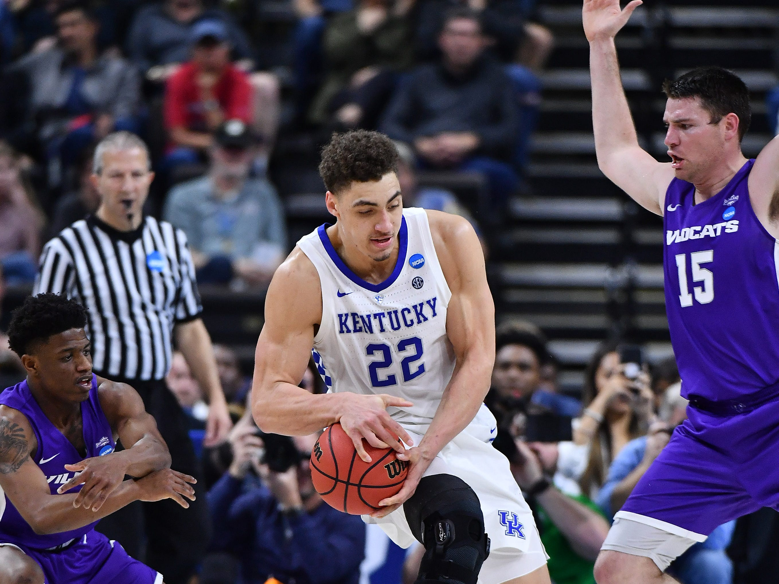 Mar 21, 2019; Jacksonville, FL, USA; Kentucky Wildcats forward Reid Travis (22) controls the ball between Abilene Christian Wildcats guard Damien Daniels (4) and Abilene Christian Wildcats forward Hayden Farquhar (15) during the first half in the first round of the 2019 NCAA Tournament at Jacksonville Veterans Memorial Arena. Mandatory Credit: John David Mercer-USA TODAY Sports