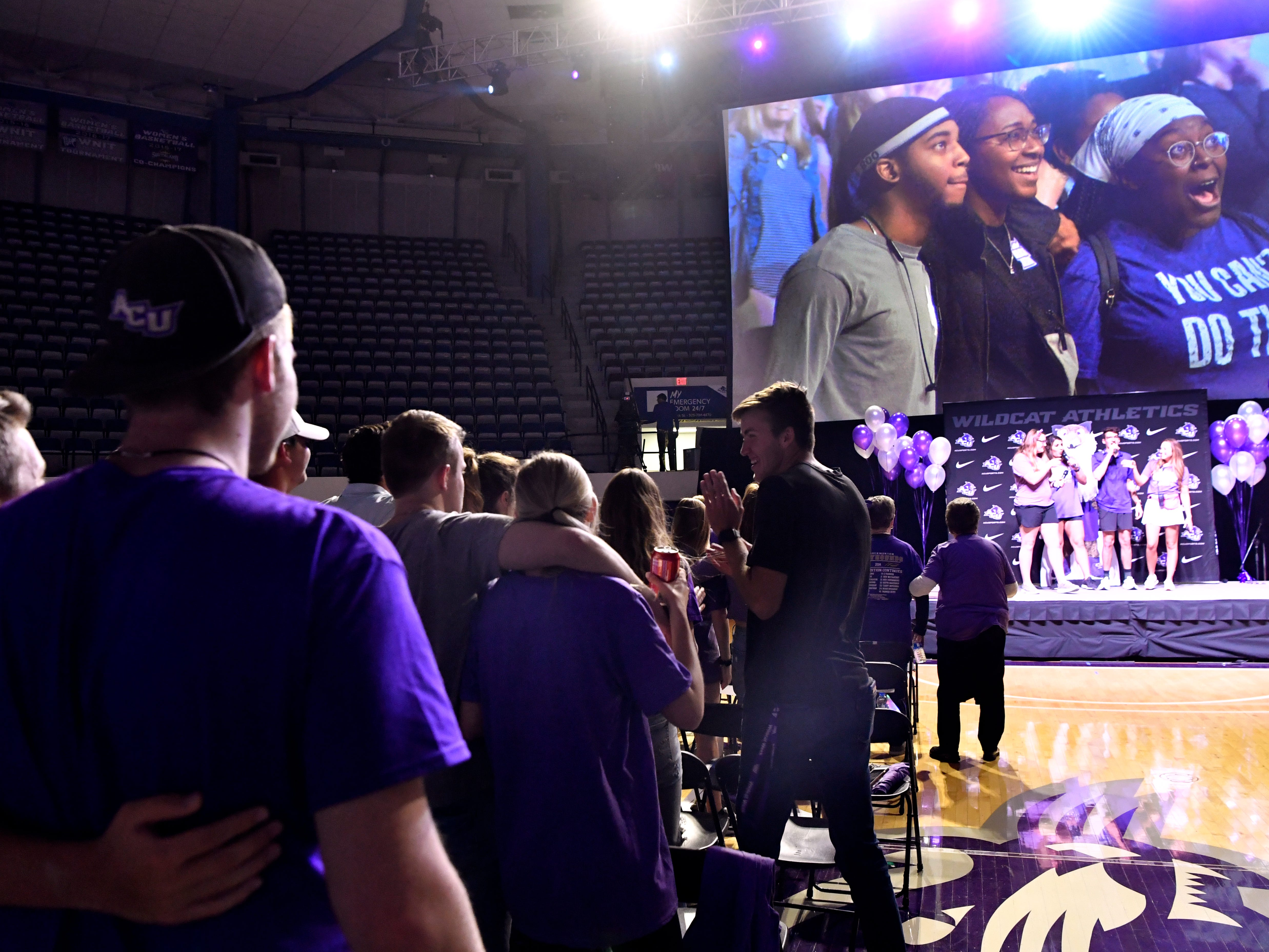 Students and fans sing the school song in Abilene Christian University's Moody Coliseum at the conclusion of Thursday's watch party March 21, 2019. The ACU men took on basketball powerhouse University of Kentucky in their first-ever trip to the NCAA Tournament. Final score was 79-44, Kentucky.