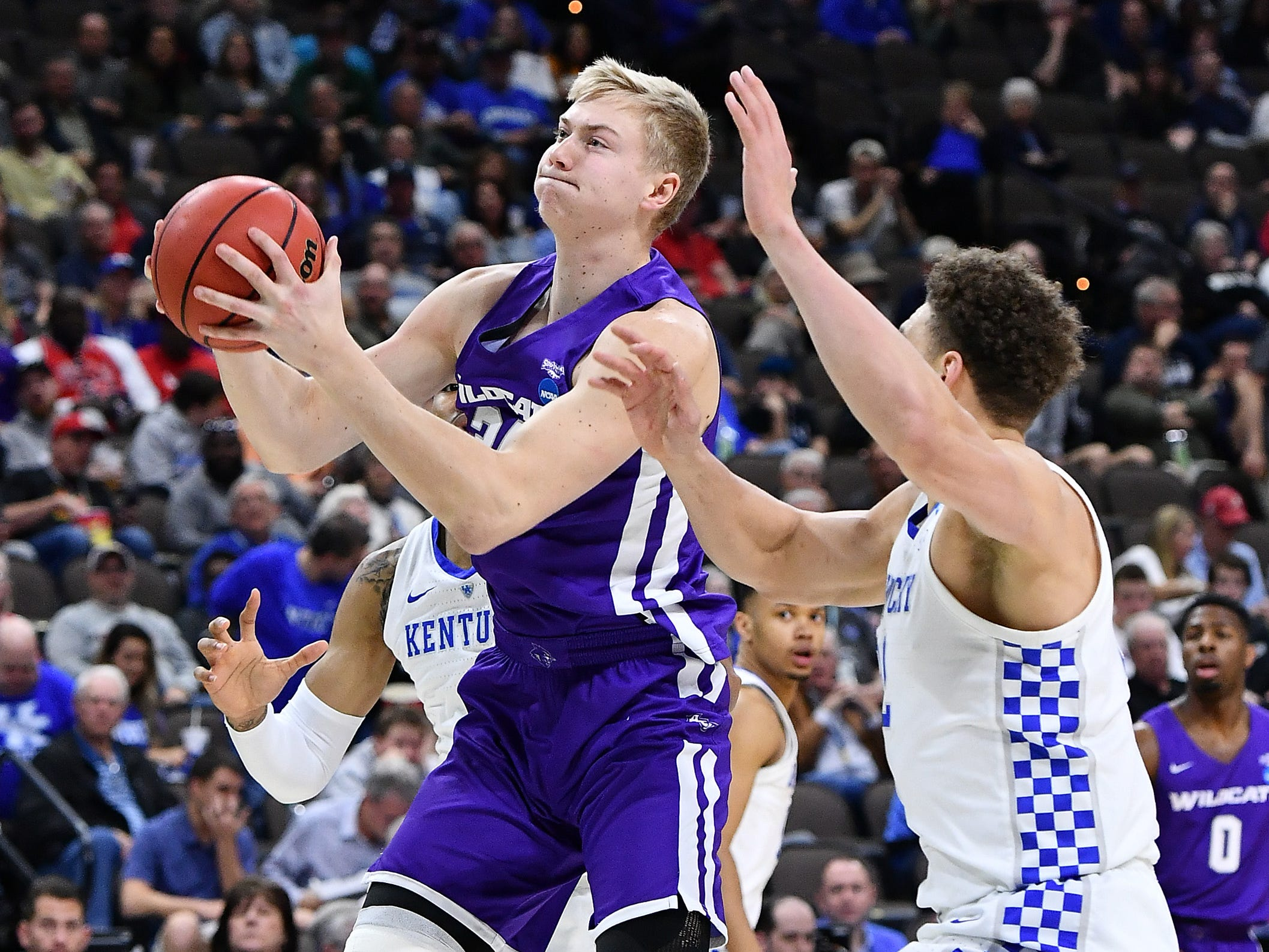 Mar 21, 2019; Jacksonville, FL, USA; Abilene Christian Wildcats center Kolton Kohl (34) shoots the ball past Kentucky Wildcats forward Reid Travis (22) during the first half in the first round of the 2019 NCAA Tournament at Jacksonville Veterans Memorial Arena. Mandatory Credit: John David Mercer-USA TODAY Sports