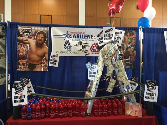 An award-winning wrestling-themed booth by Communities of Abilene Federal Credit Union in 2016 at the yearly Business Expo.