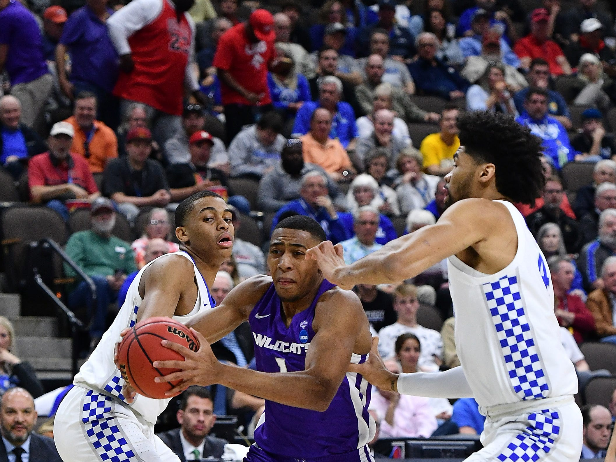 Mar 21, 2019; Jacksonville, FL, USA; Abilene Christian Wildcats forward Jaren Lewis (1) dribbles the ball as Kentucky Wildcats forward Reid Travis (22) defends during the first half in the first round of the 2019 NCAA Tournament at Jacksonville Veterans Memorial Arena. Mandatory Credit: John David Mercer-USA TODAY Sports
