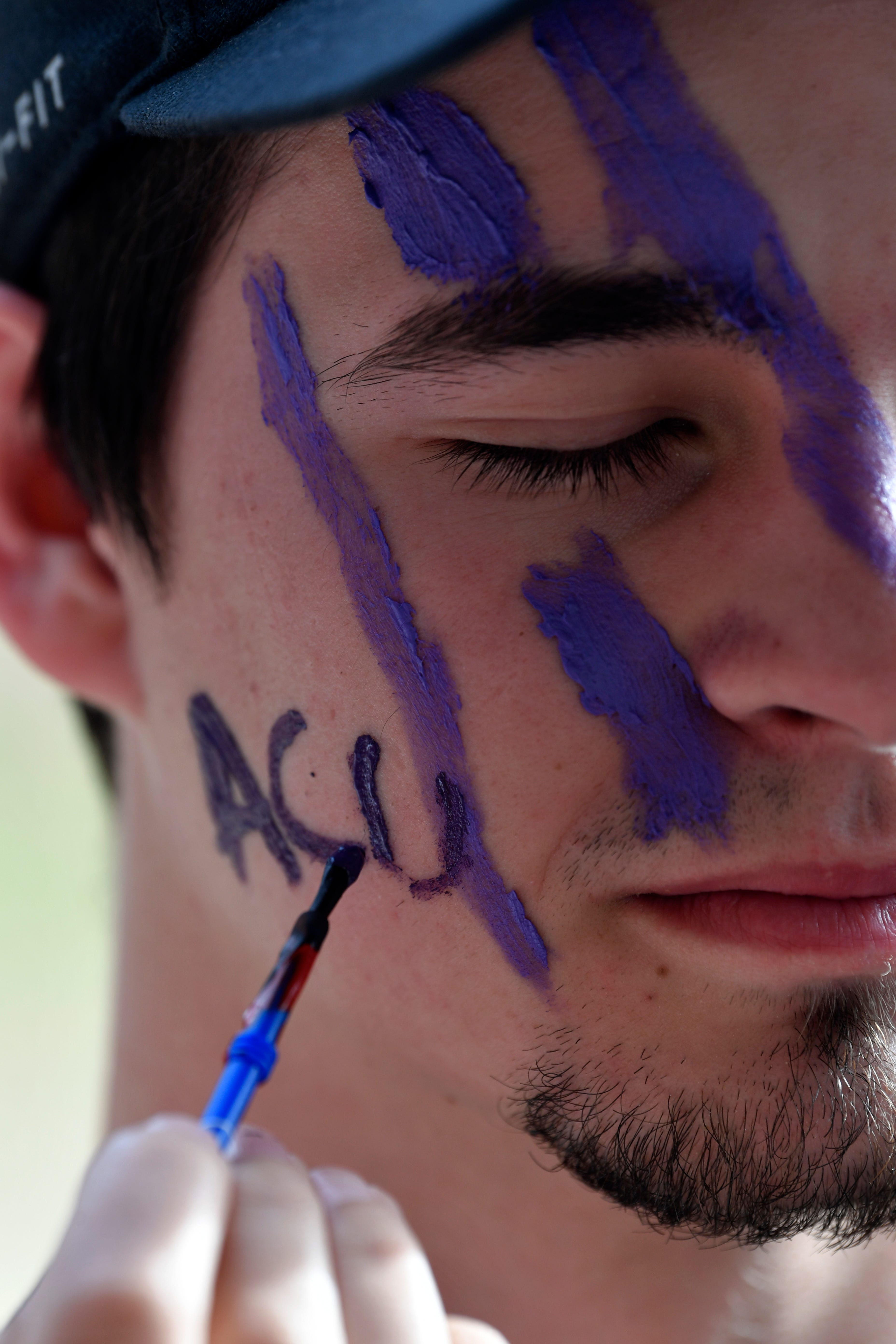 Skylar Griffin closes his eyes as Epiphany Mitchell finishes painting his face before Thursday's watch party at Abilene Christian University's Moody Coliseum March 2,1, 2019. The ACU men took on basketball powerhouse University of Kentucky in their first-ever trip to the NCAA Tournament. Final score was 79-44, Kentucky.