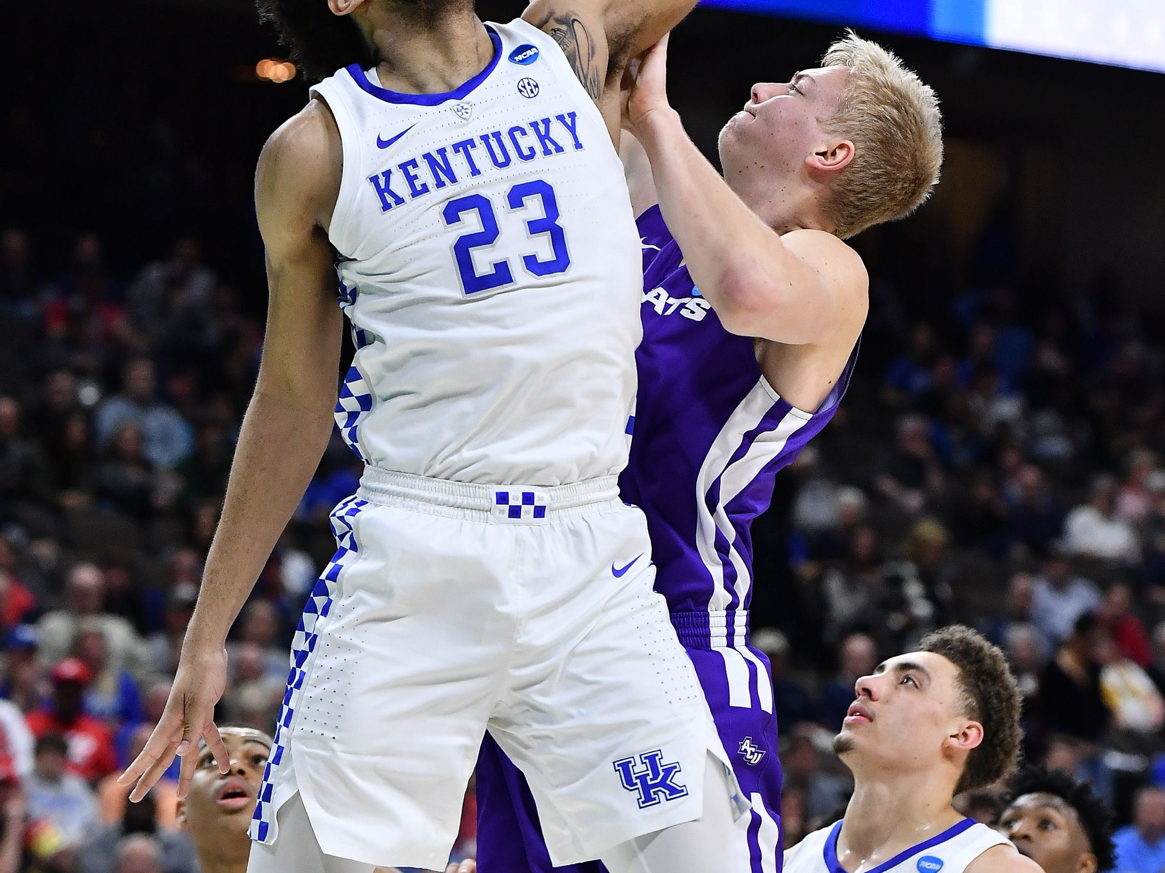 Mar 21, 2019; Jacksonville, FL, USA; Abilene Christian Wildcats center Kolton Kohl (34) shoots the ball as Kentucky Wildcats forward EJ Montgomery (23) defends during the first half in the first round of the 2019 NCAA Tournament at Jacksonville Veterans Memorial Arena. Mandatory Credit: John David Mercer-USA TODAY Sports