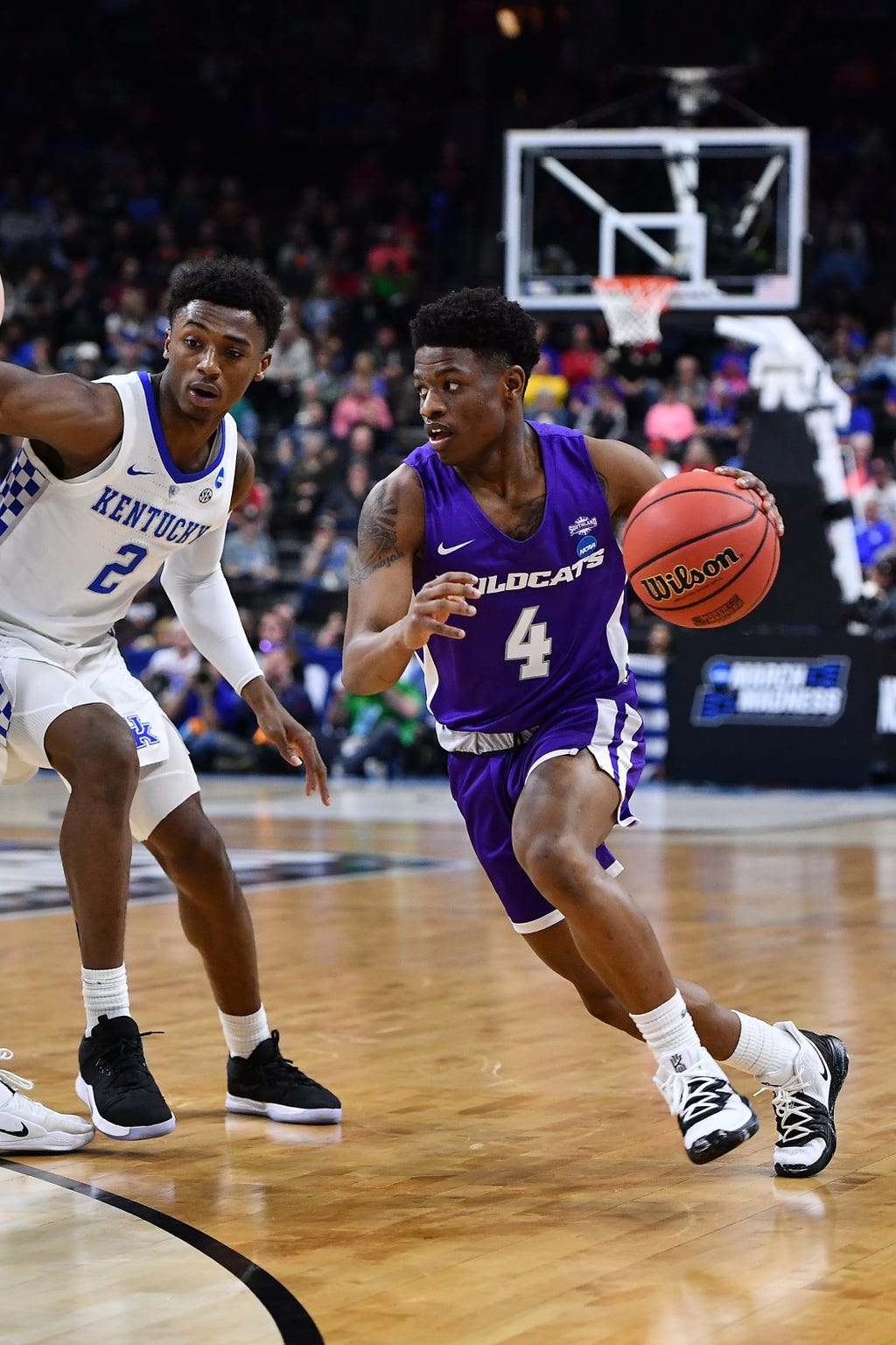 ACU guard Damien Daniels (4) dribbles the ball as Kentucky guard Ashton Hagans (2) defends during the first round of the 2019 NCAA tournament in Jacksonville. The Wildcats won the Southland Conference tournament to earn its first-ever birth to the Division I tournament in their first year of eligibility.