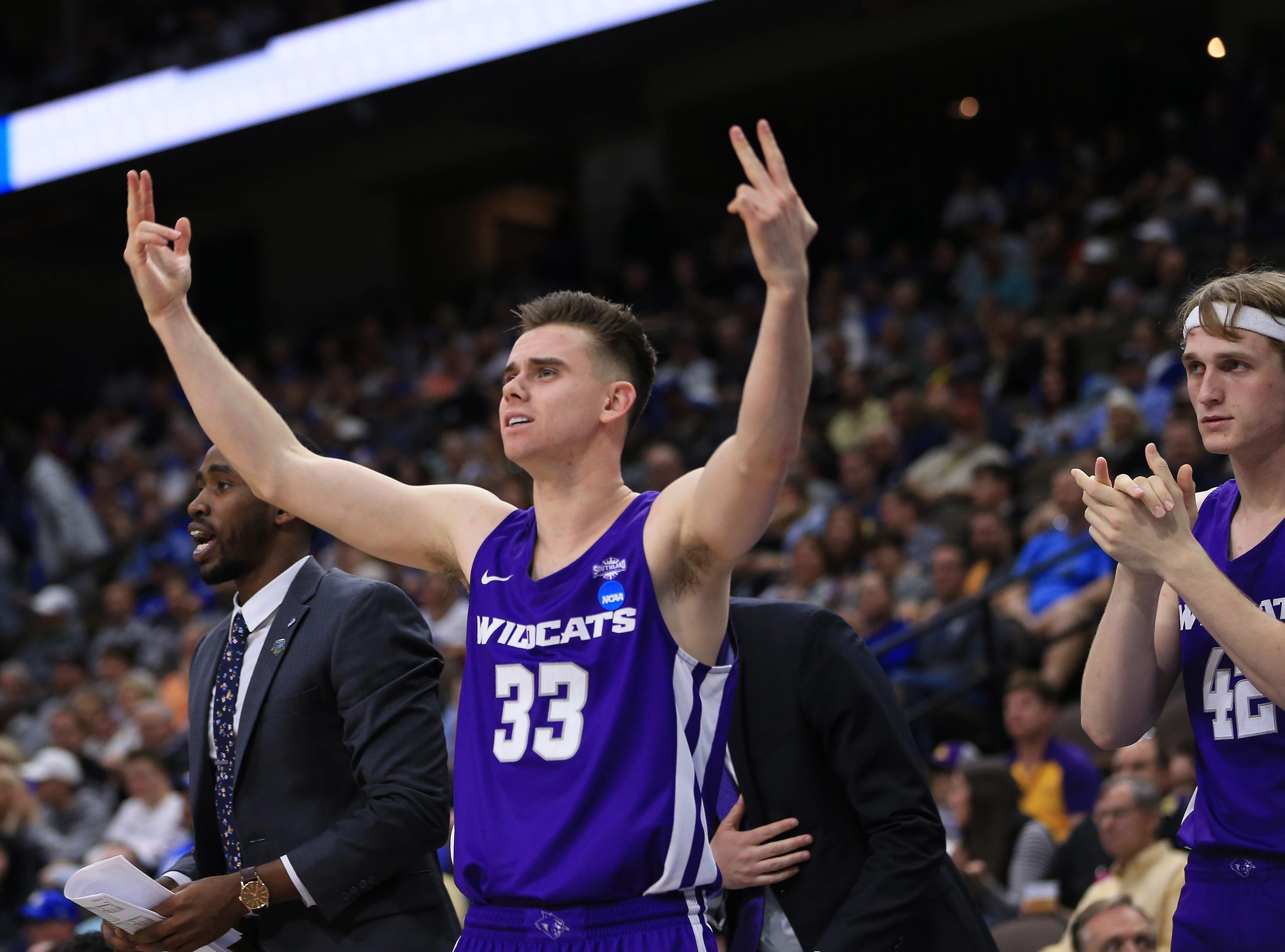 Mar 21, 2019; Jacksonville, FL, USA; Abilene Christian Wildcats guard Paul Hiepler (33) and Abilene Christian Wildcats forward Clay Gayman (42) react on the bench against the Kentucky Wildcats during the first half in the first round of the 2019 NCAA Tournament at Jacksonville Veterans Memorial Arena. Mandatory Credit: Matt Stamey-USA TODAY Sports