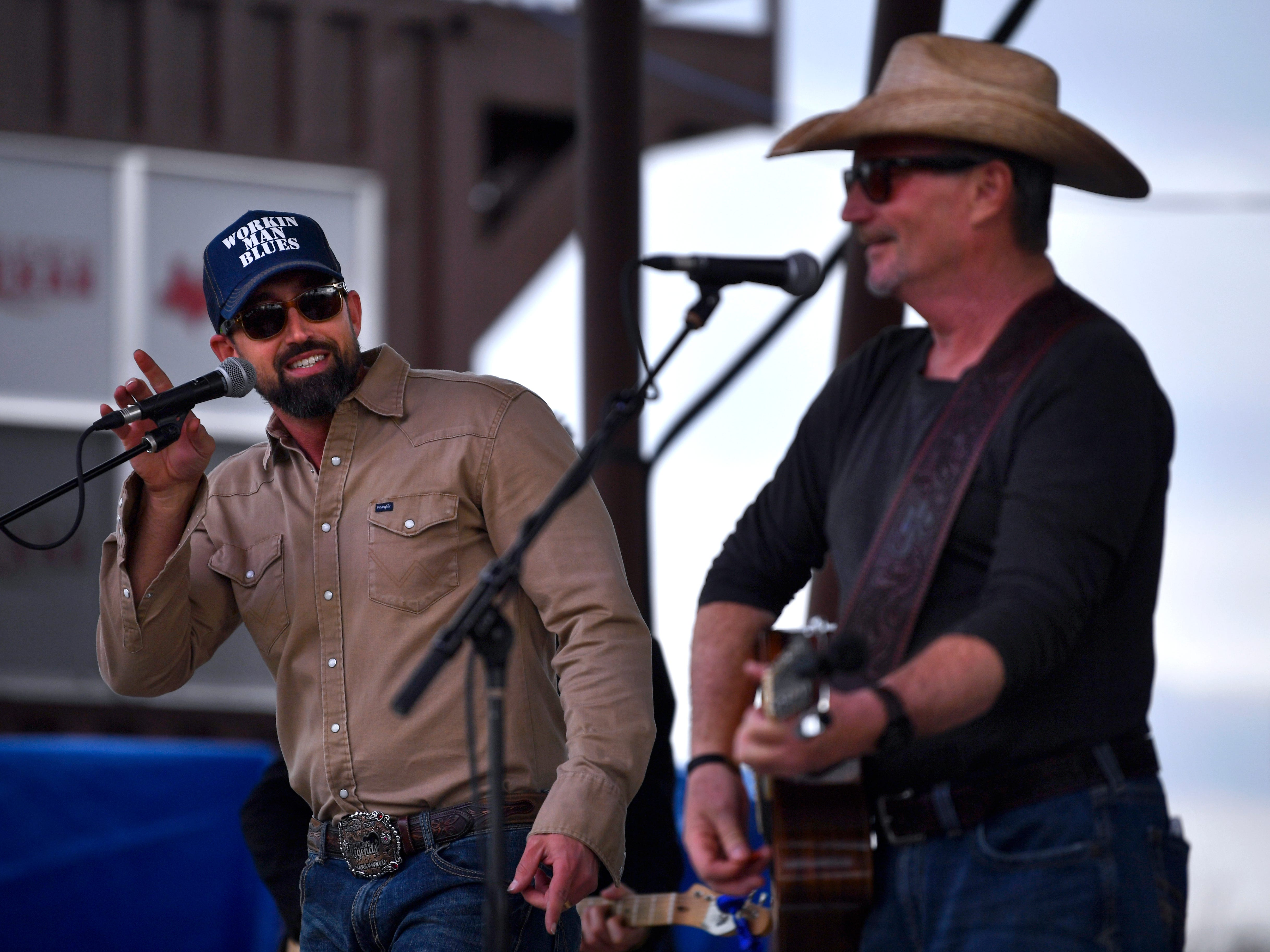 "Mark Powell sings ""Second-hand smoke"" with Jamie Richards during Friday's Outlaws & Legends music festival march 22, 2019."