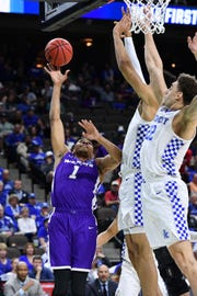 Mar 21, 2019; Jacksonville, FL, USA; Abilene Christian Wildcats forward Jaren Lewis (1) shoots the ball against the Kentucky Wildcats during the first half in the first round of the 2019 NCAA Tournament at Jacksonville Veterans Memorial Arena. Mandatory Credit: John David Mercer-USA TODAY Sports